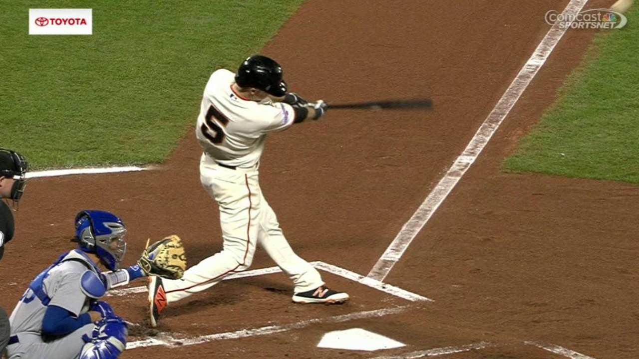 Injuries abound, infield bats rule in Giants' 2015