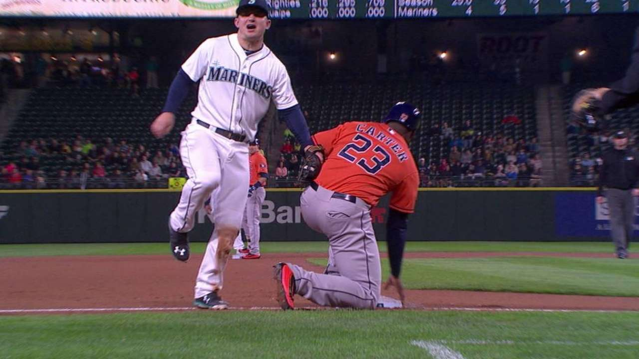 Carter out at third after review