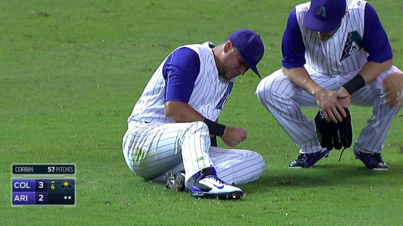 Peralta injured on awkward slide for fly ball