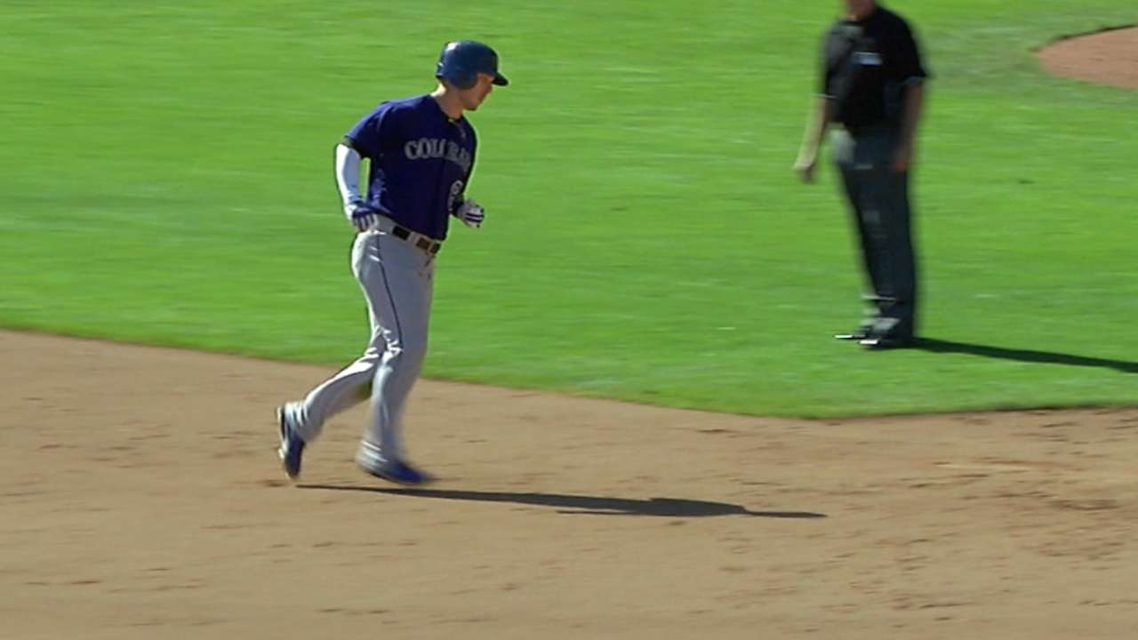 Rockies rally big in ninth to beat Giants in finale