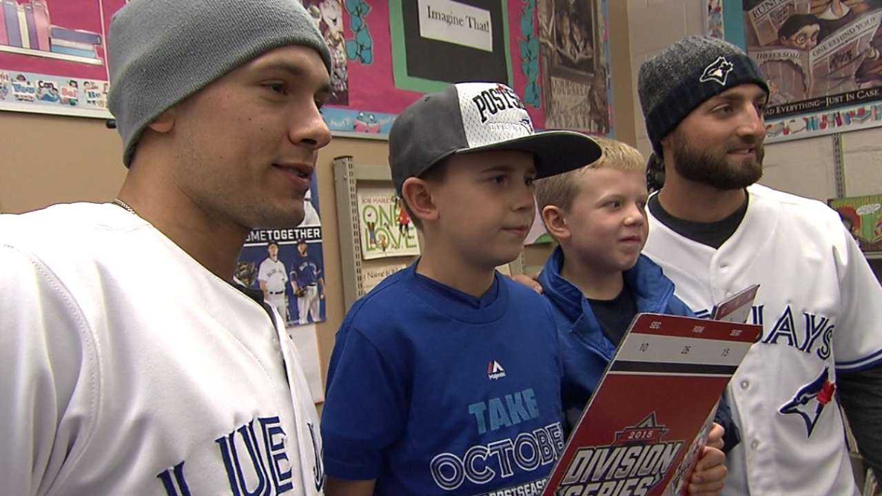 Goins, Pillar surprise young fan with ALDS tickets