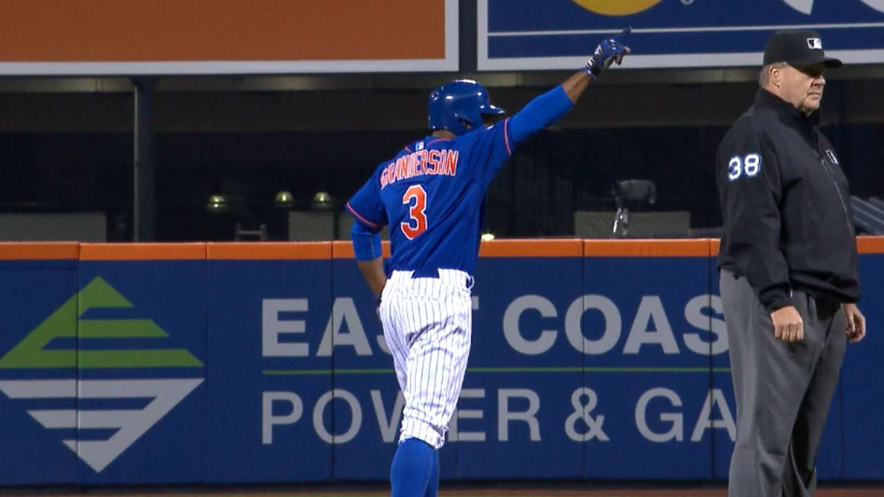 Grandy makes up for error with dandy at plate