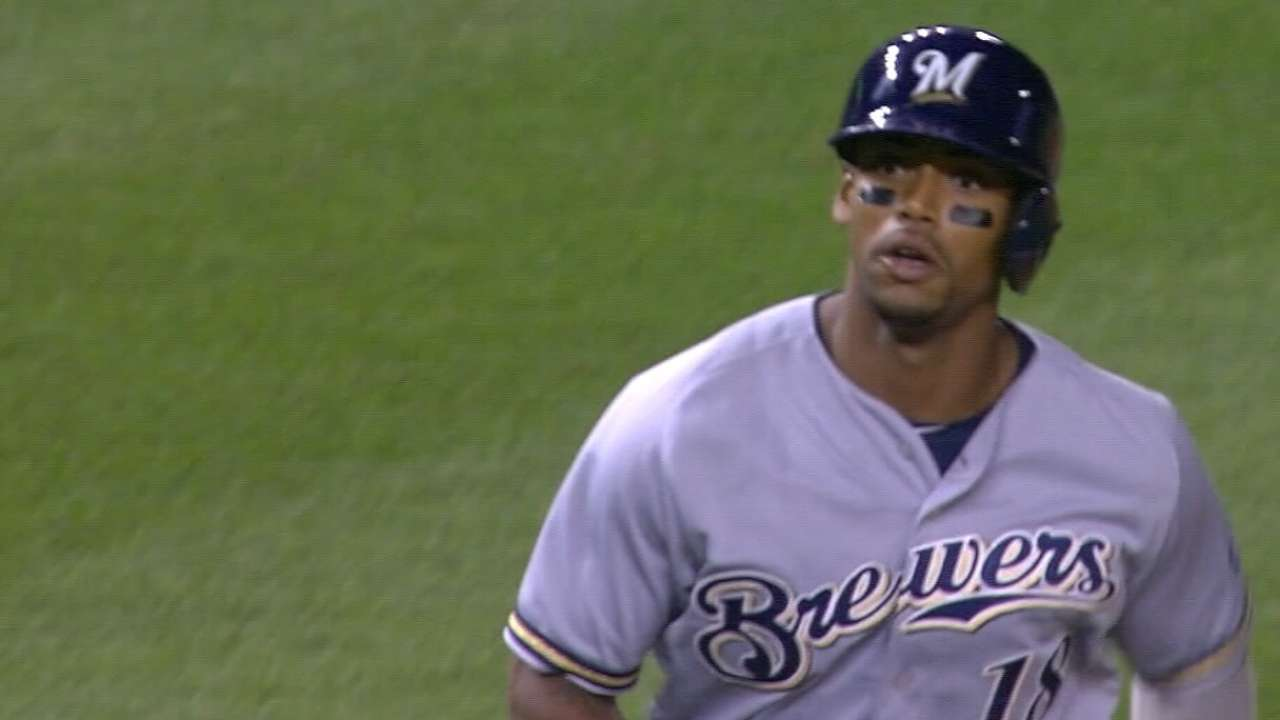 A's land slugging outfielder Davis from Brewers