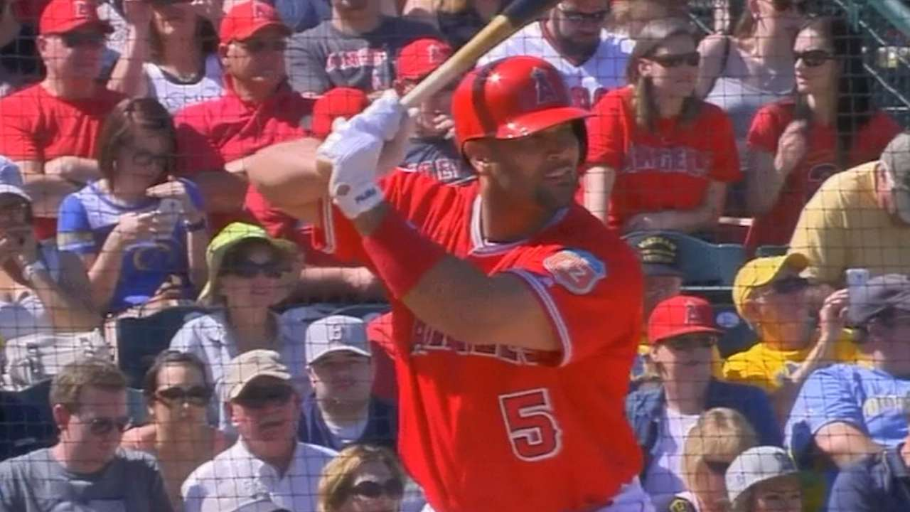 Pujols willing to DH more, but still loves glove