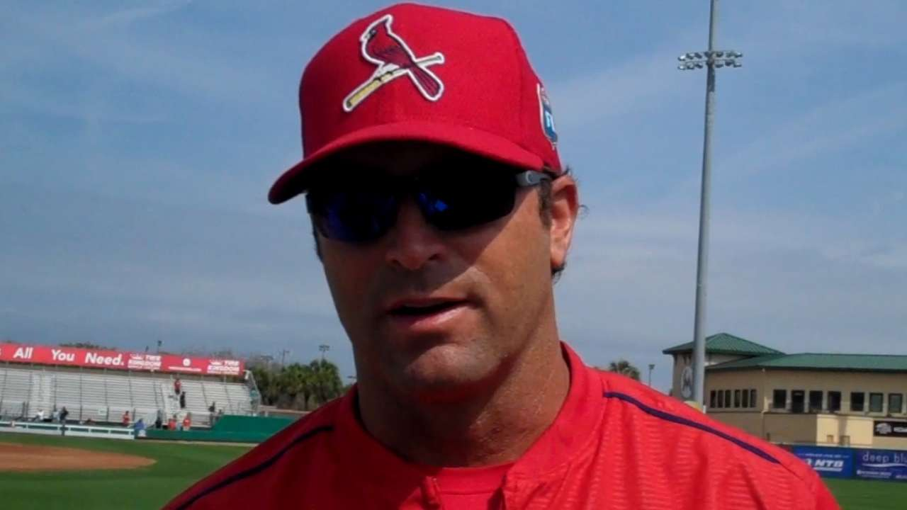 Cardinals reduce camp roster by nine