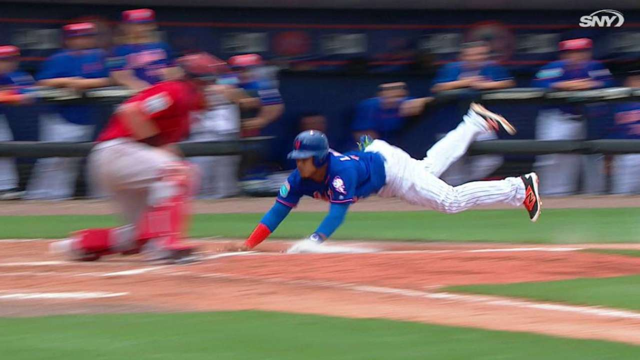 Stealing a moment: Lagares swipes home vs. Sox