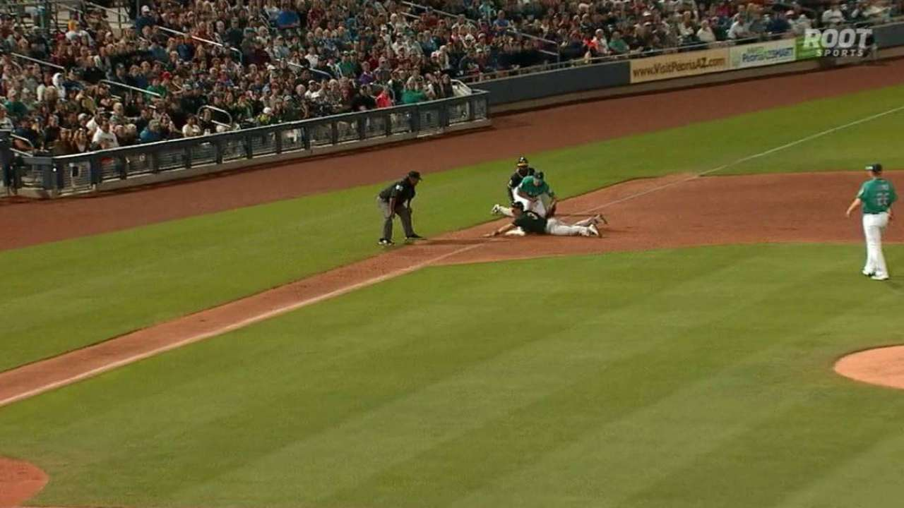 Coghlan, A's outlast Seattle in wild hit parade