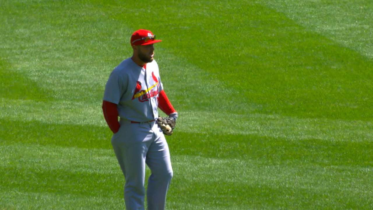 Holliday's debut at 1B lasts until Pham exits