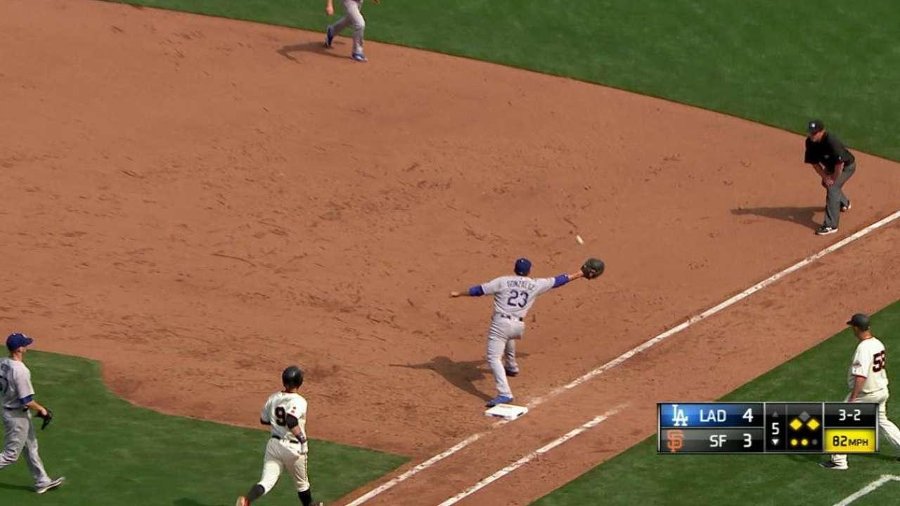 Gonzalez picks Utley's throw