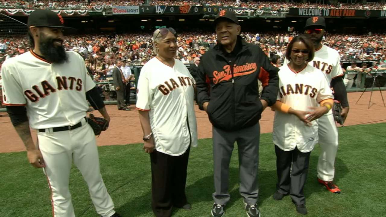 Irvin family throws first pitch