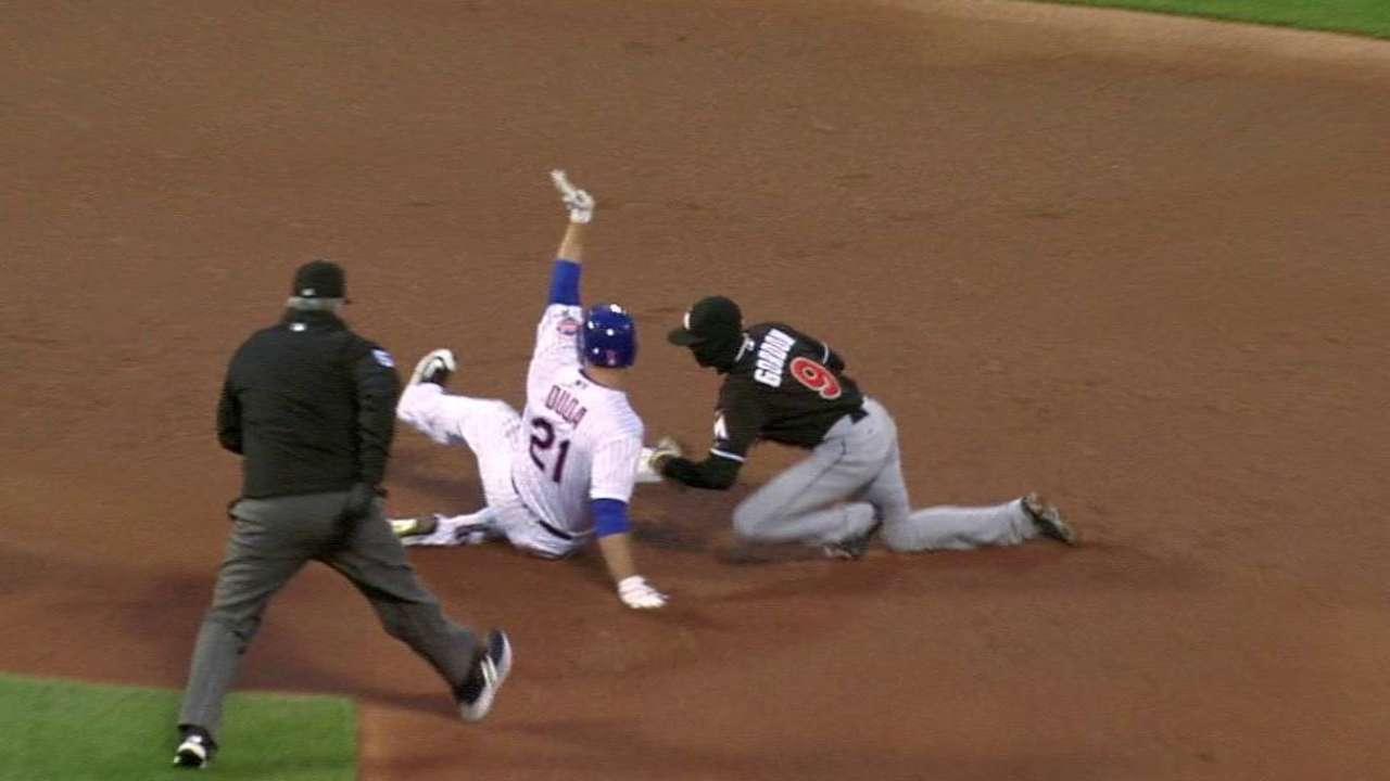 Ozuna throws out Duda at second