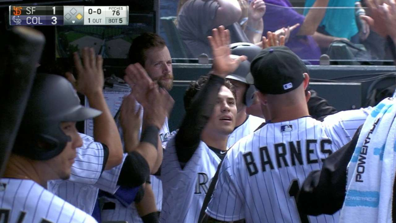Rockies' 9-run frame beats Giants in rubber game