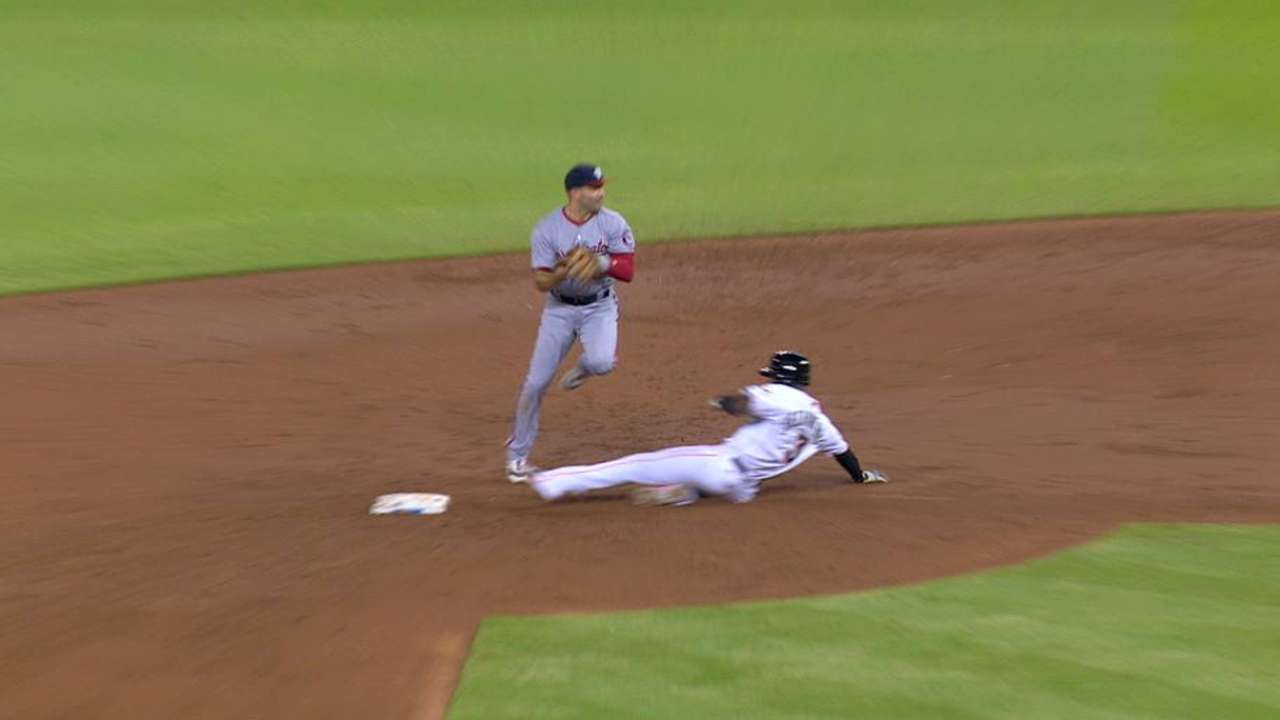 Hechavarria safe at second