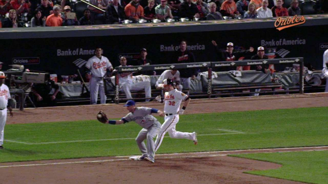 Wieters beats throw to first