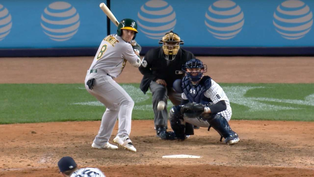 Lowrie collects four hits