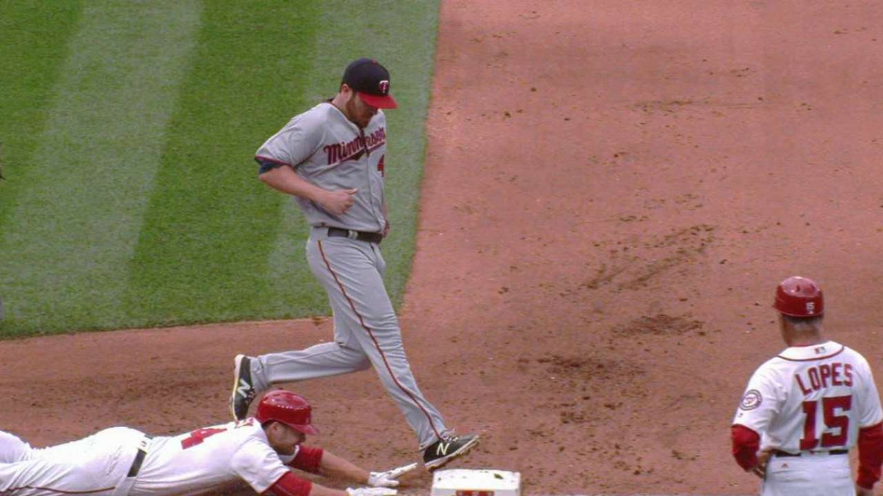 Hughes beats Heisey to first