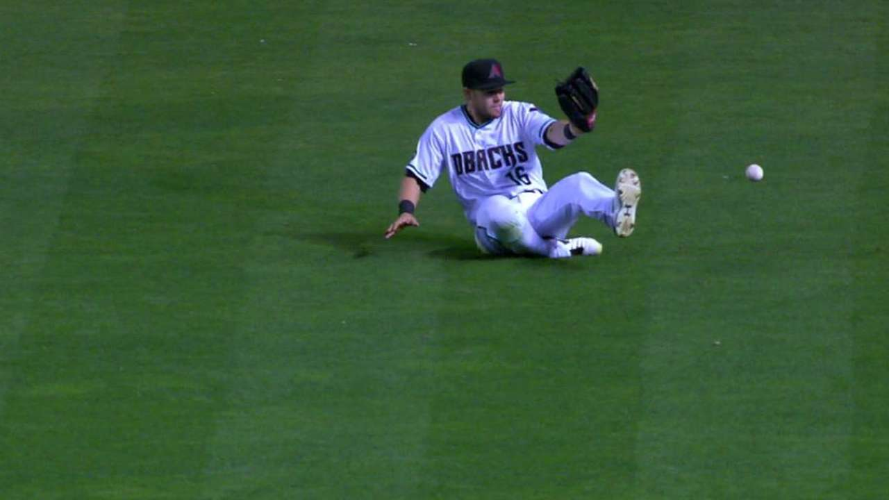 Owings working hard to improve in center field