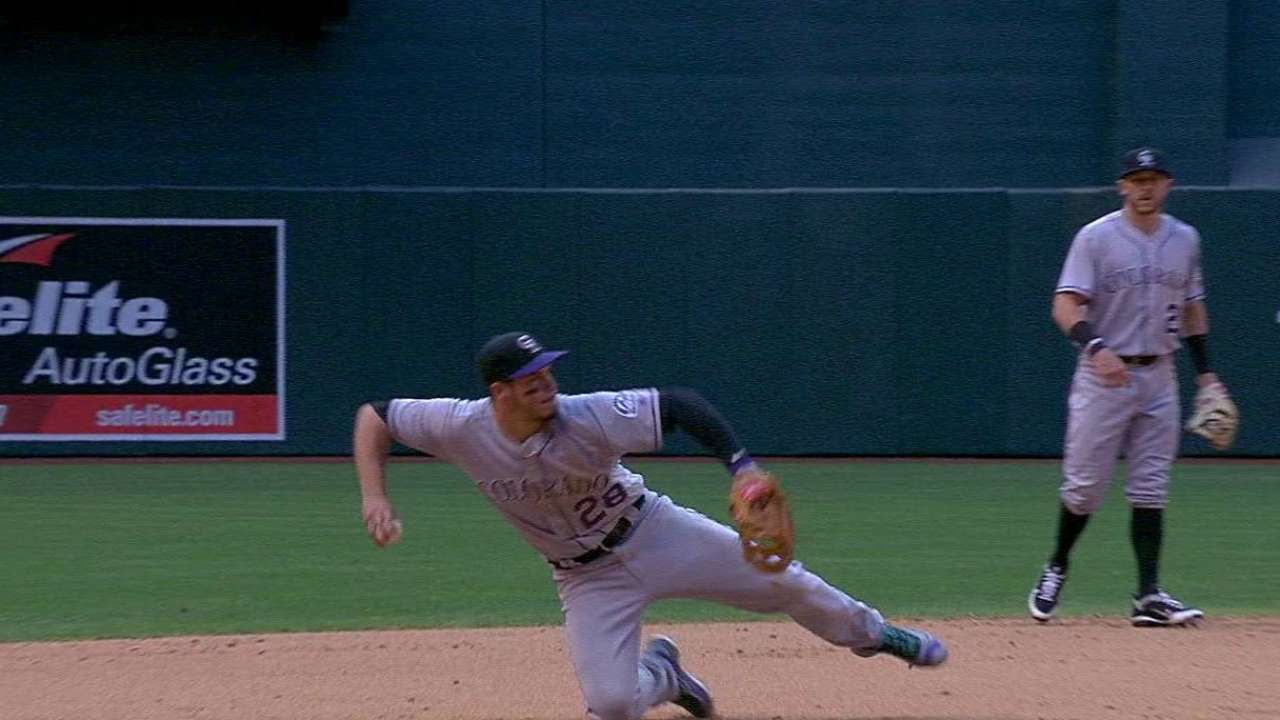 Arenado dives, throws from knees