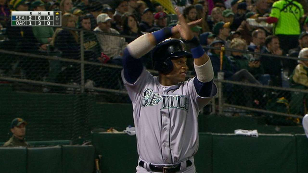Cano, Seattle spoil Davis' power show, top A's