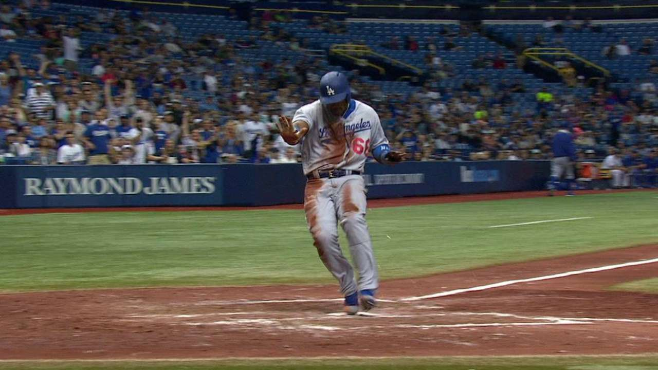 Puig scores on wild pitch