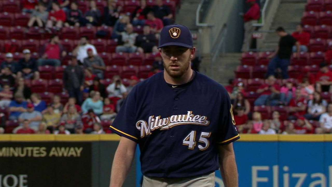 Brewers keep Cravy to aid thin bullpen