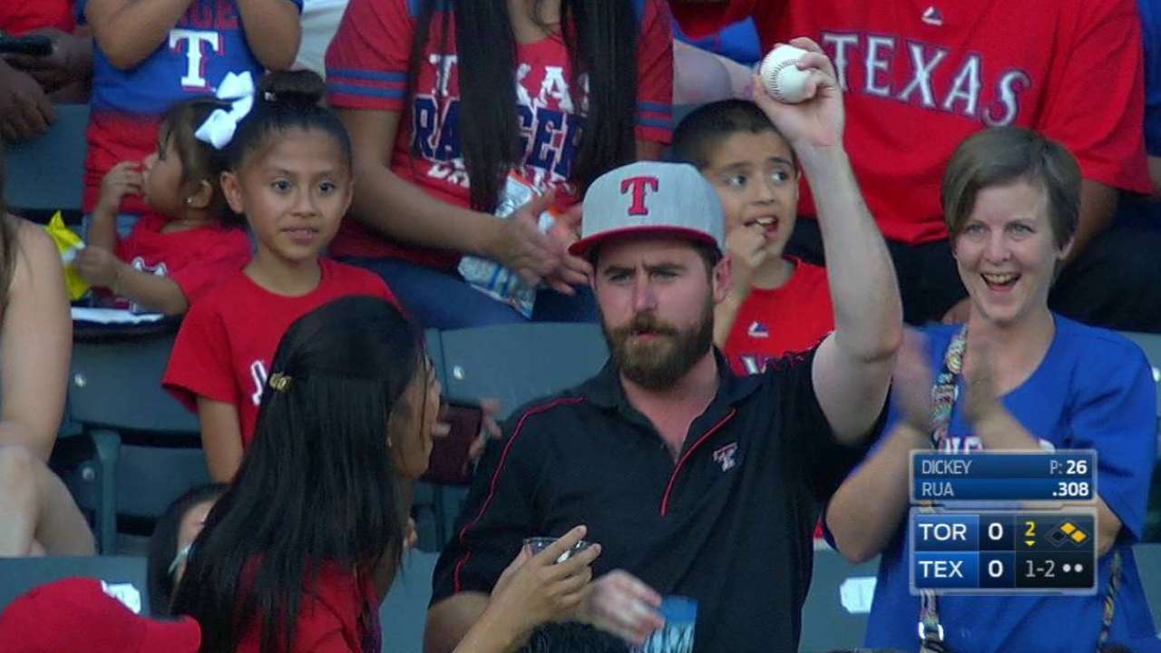Fans makes catch on a foul ball