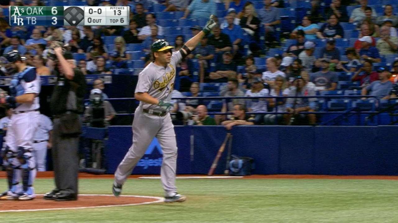 Valencia uses bat, glove in win