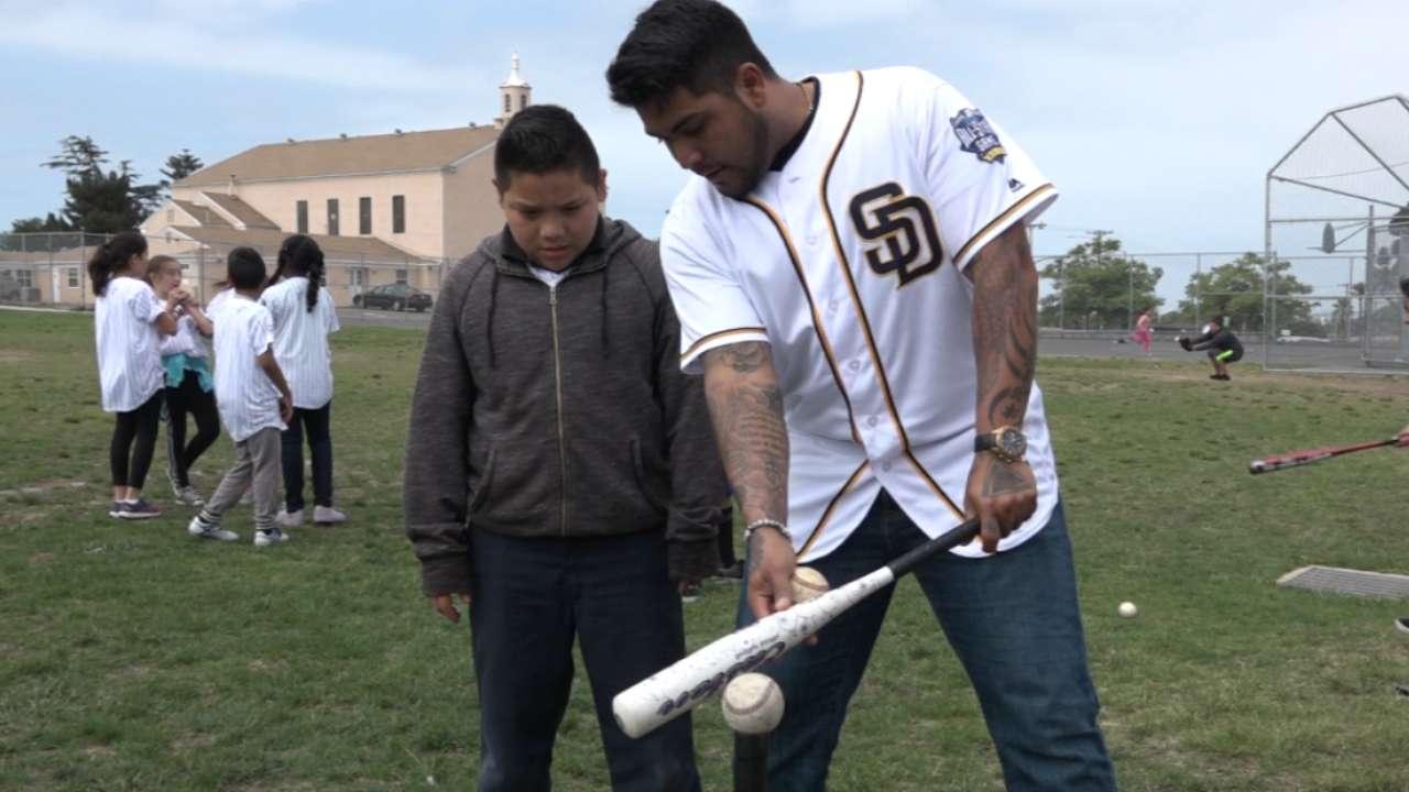 Padres visit baseball clinic