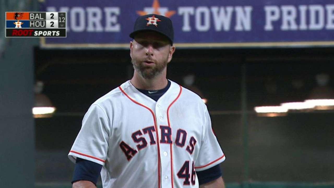 Feldman's long relief boosts Astros in extras