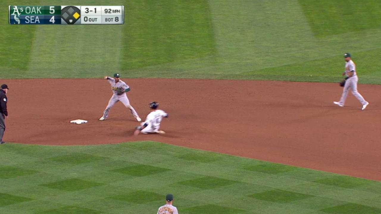 A's turn double play in the 8th