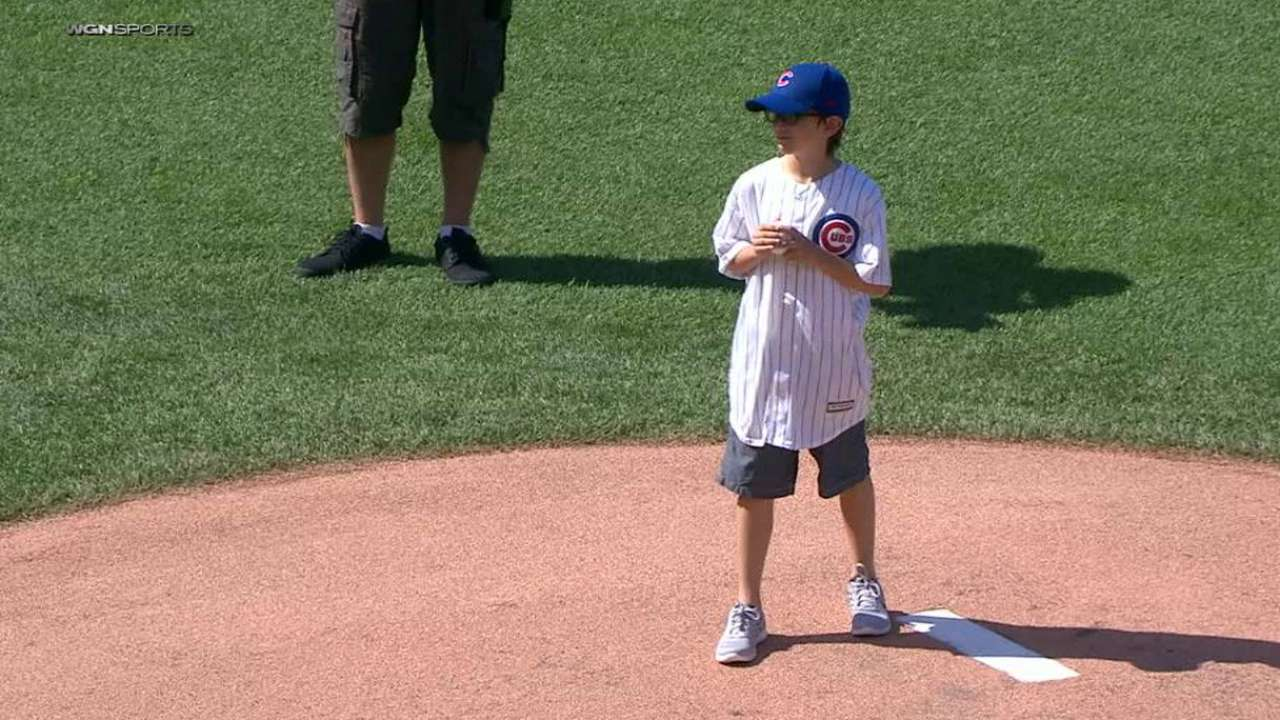 Soldier's son throws first pitch