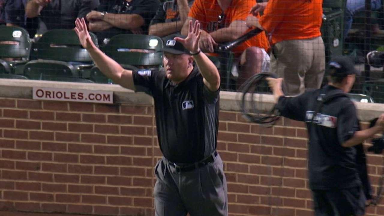 Umpires rule fly ball foul