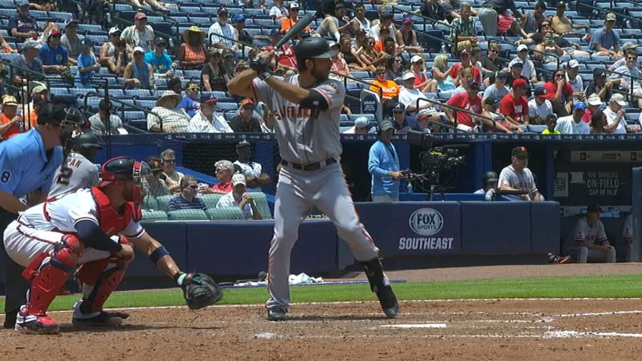 Bumgarner's king of the hill ... with a bat