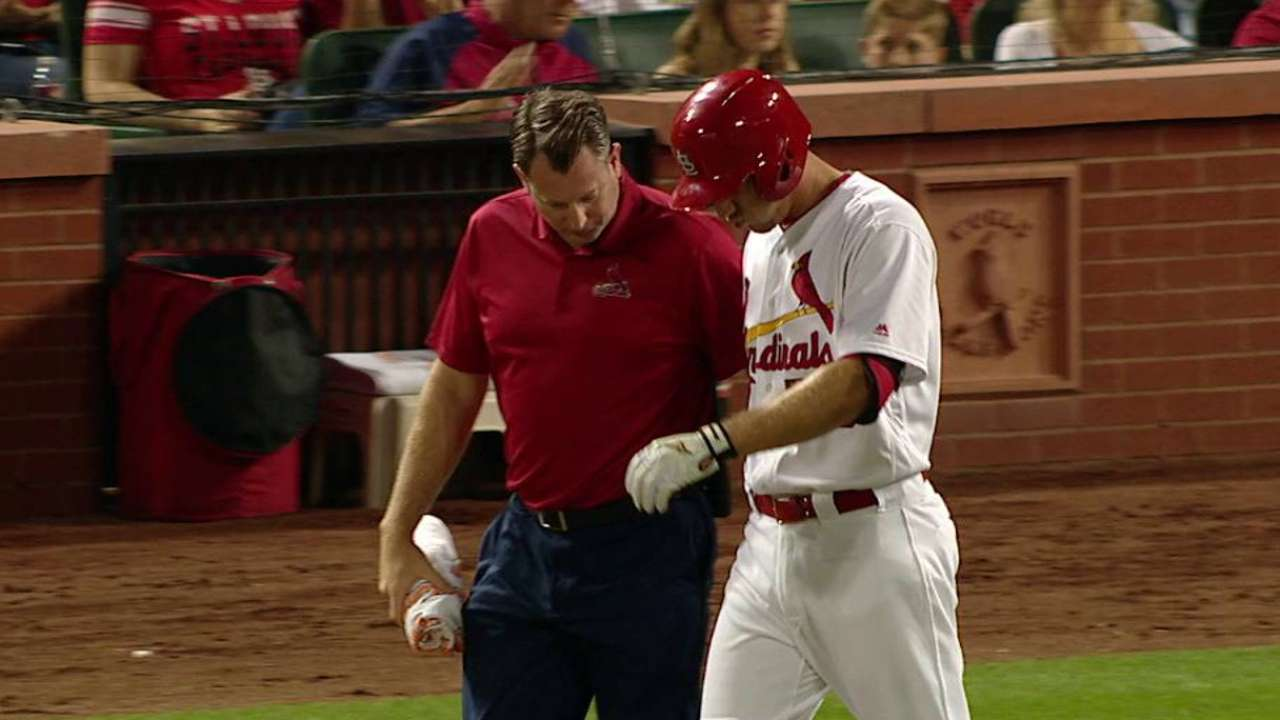 Piscotty hit by pitch, stays in