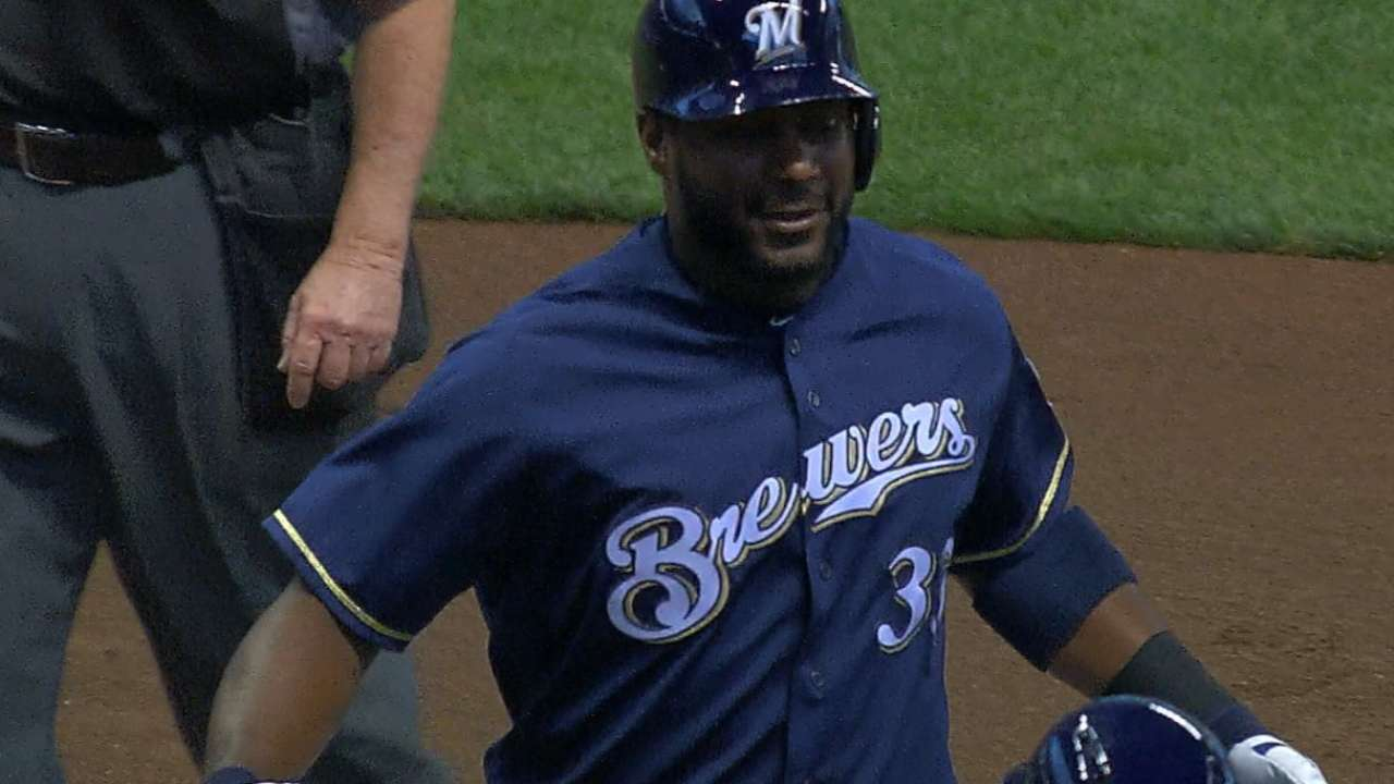 Carter's HRs, 5 RBIs propel Brewers past A's