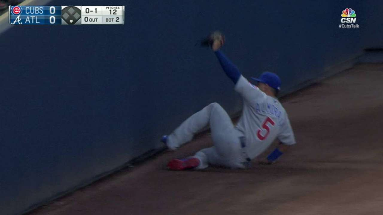 Almora Jr. showcasing glove with help from friends