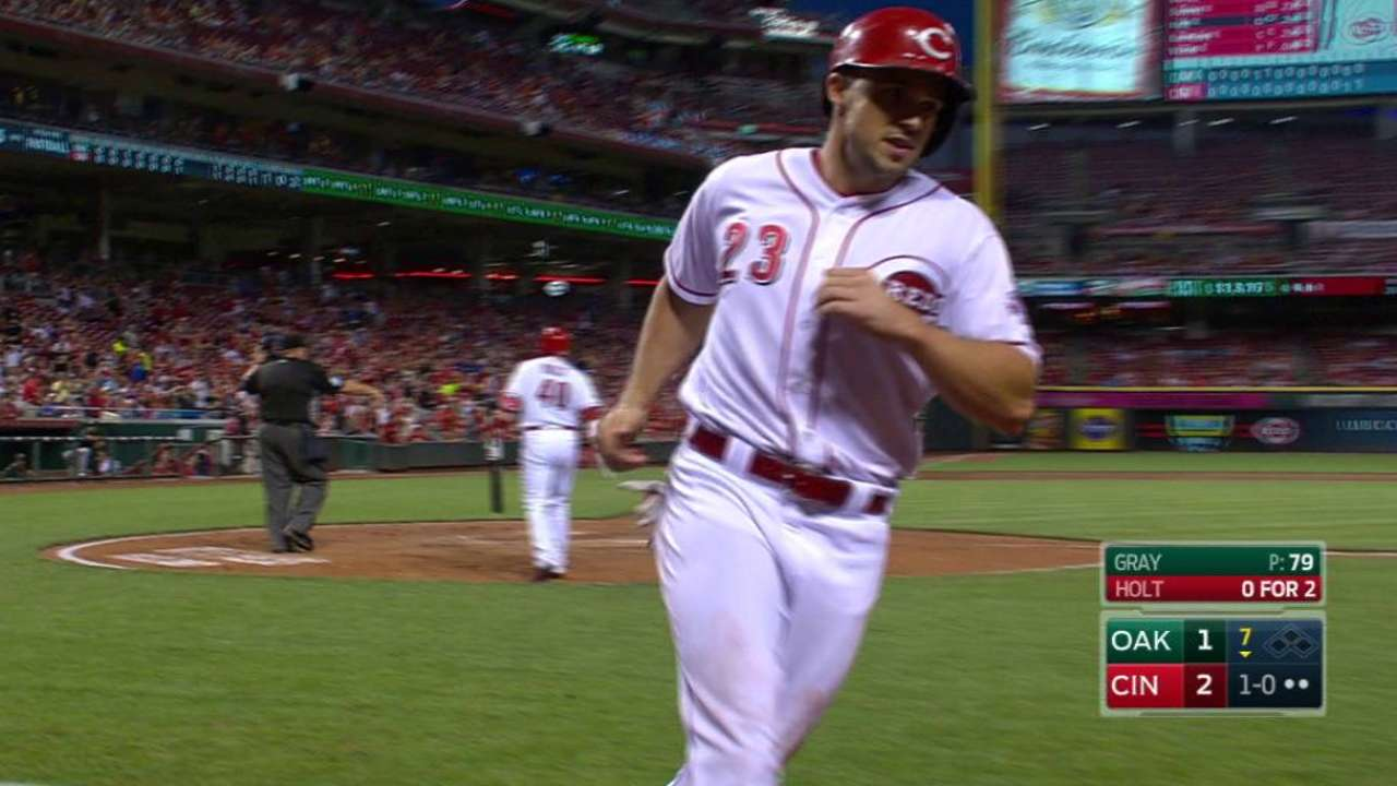 Gray takes no-no into 6th; Reds beat A's late