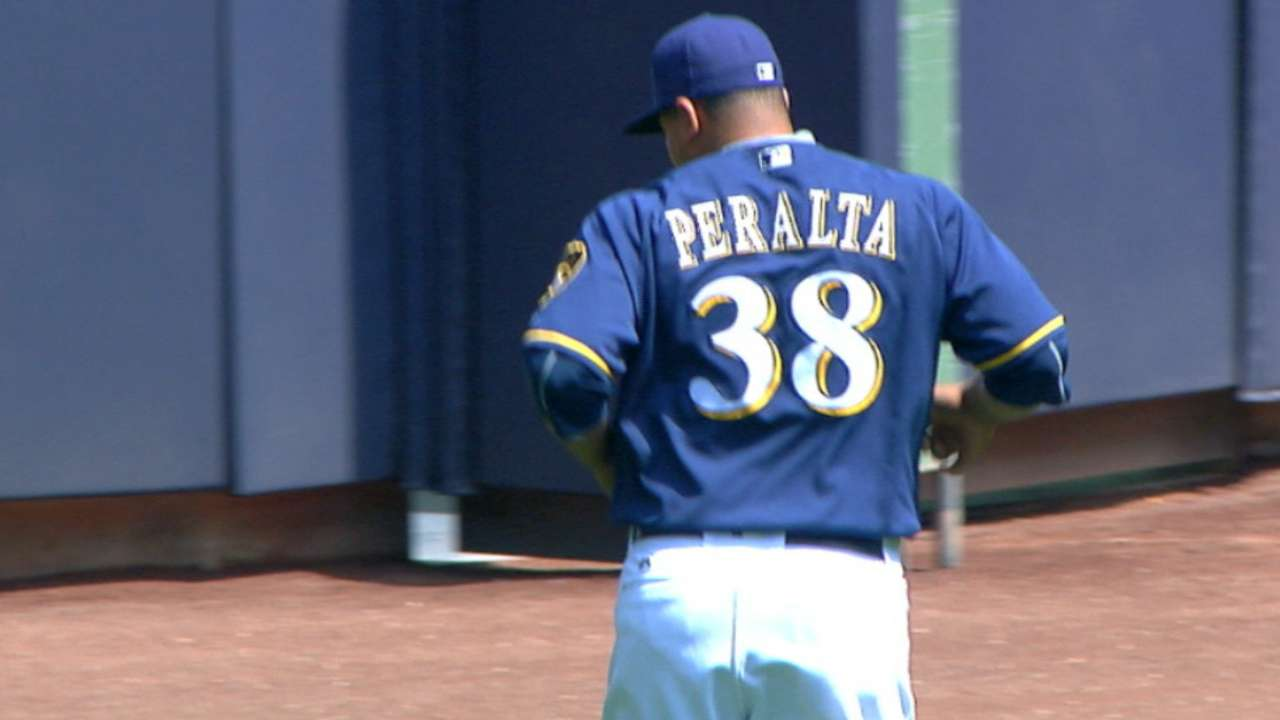 Peralta contributes with arm, bat in win