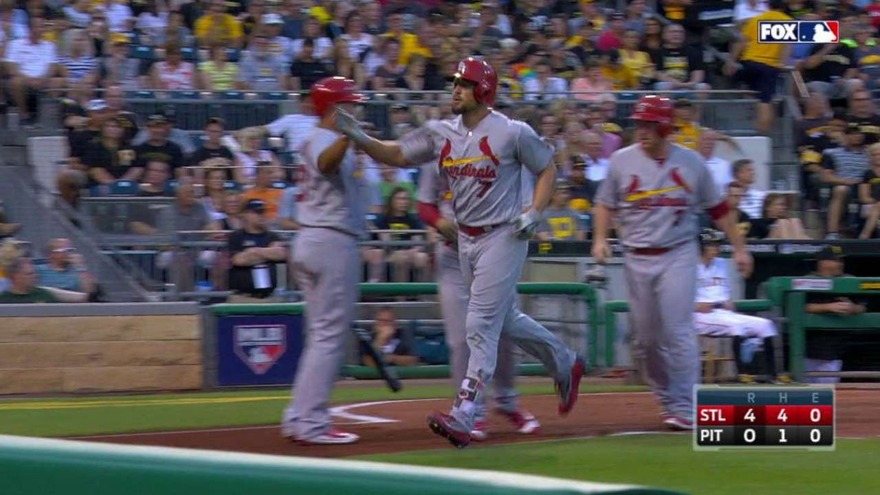 Martinez, Holliday secure Cards' 4th straight W