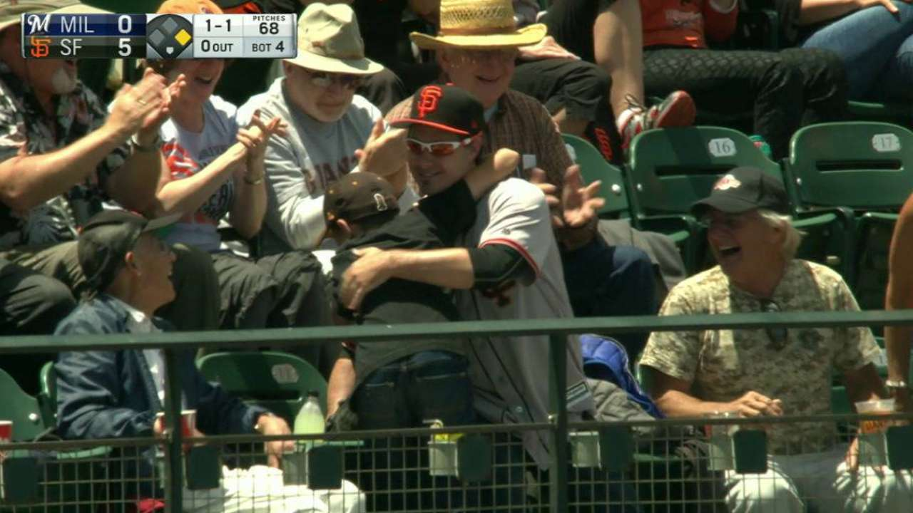 Young fan is given a foul ball