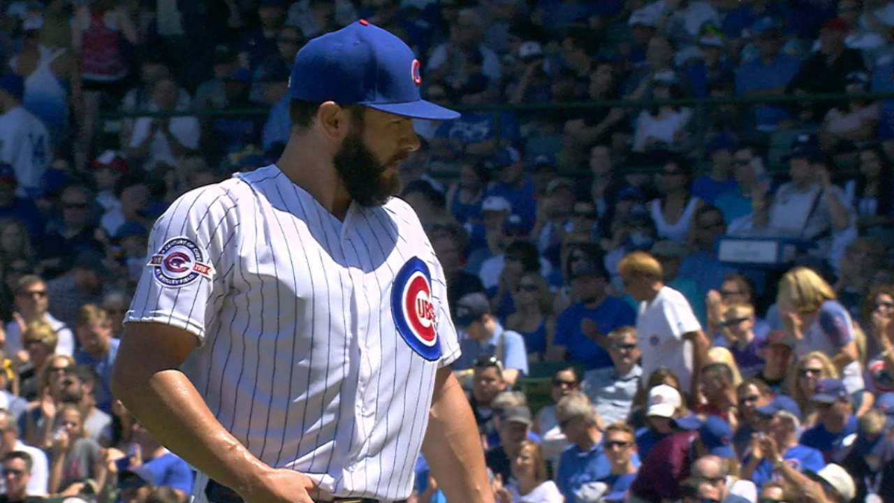 Faced with rare bit of adversity, Arrieta prevails