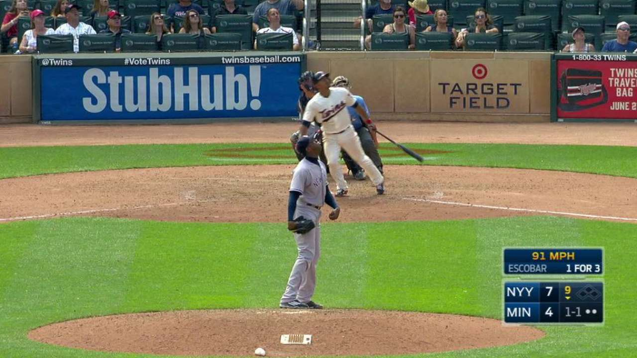 Escobar swinging hot bat in limited role