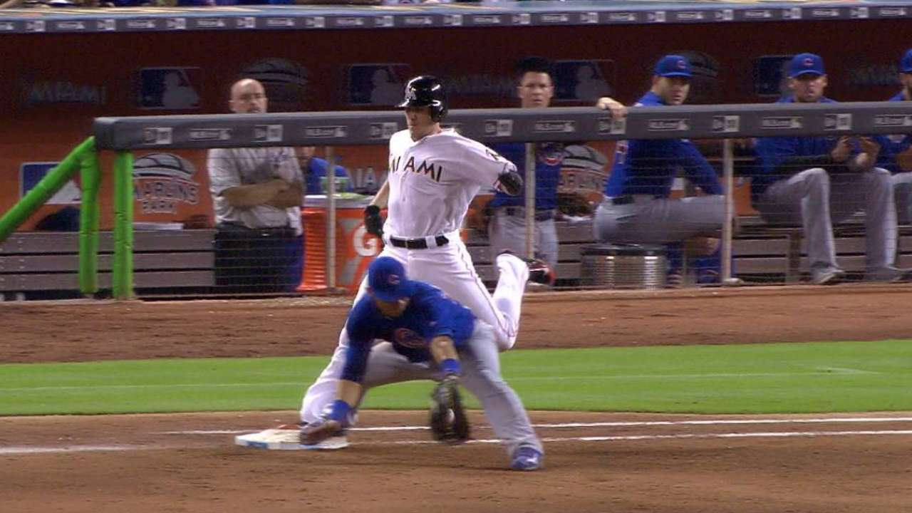 Realmuto ruled safe at first