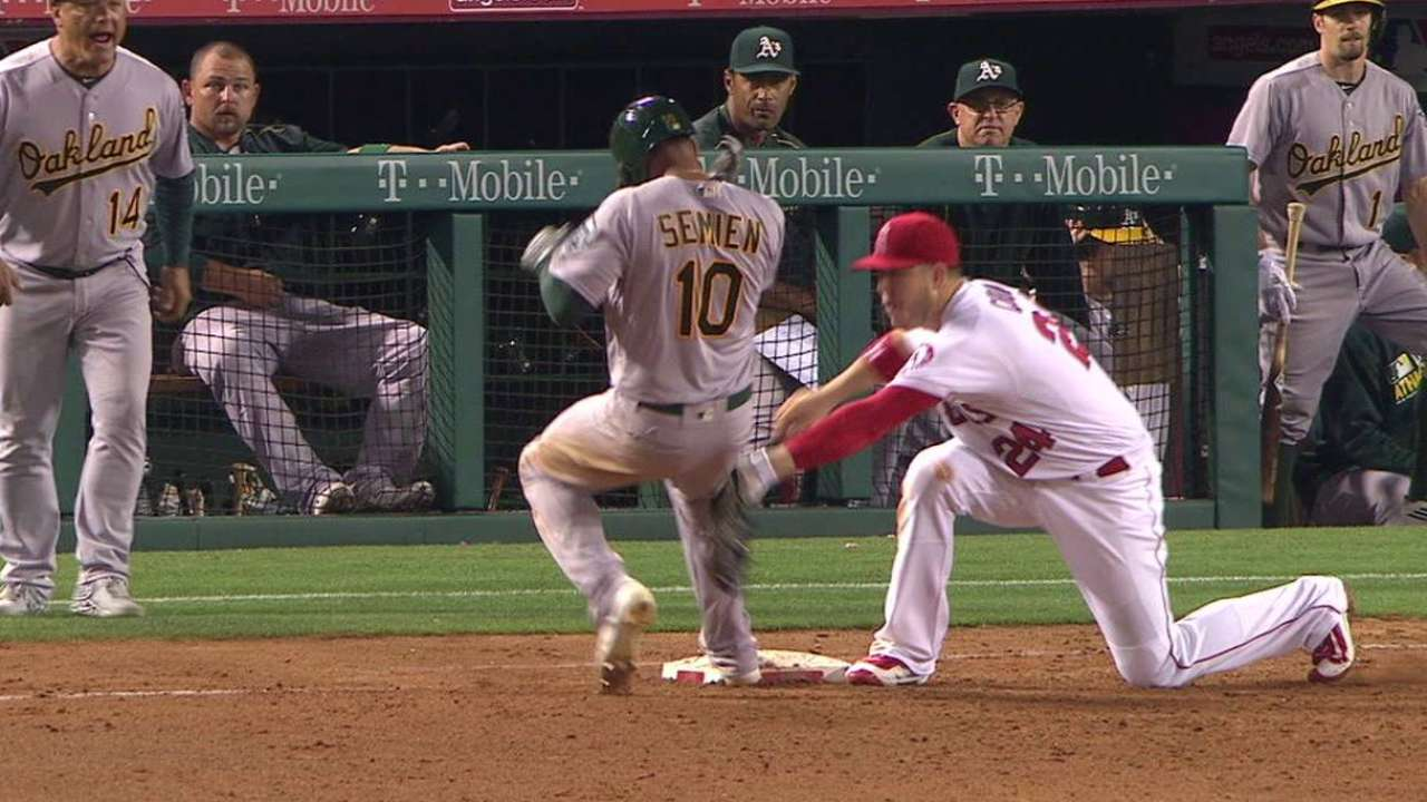 Simmons throws out Semien
