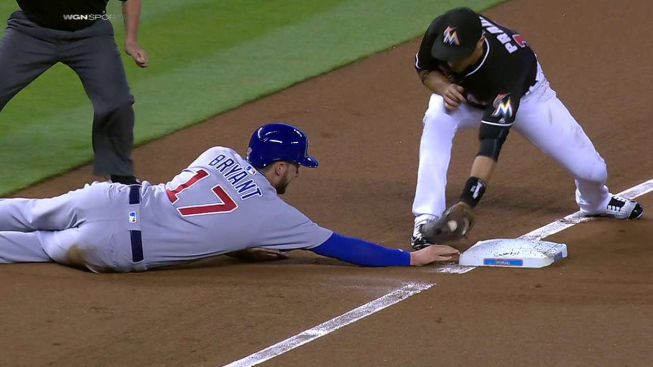 Bryant safe at third on review