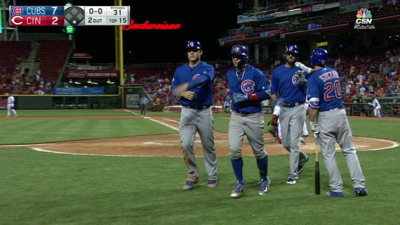 Cubs win marathon on single, slam in 15th