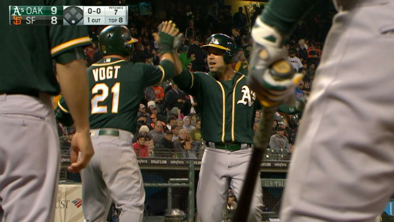 A's plate five runs in the 8th