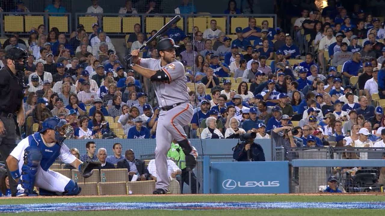 Bumgarner a hit with attitude at plate