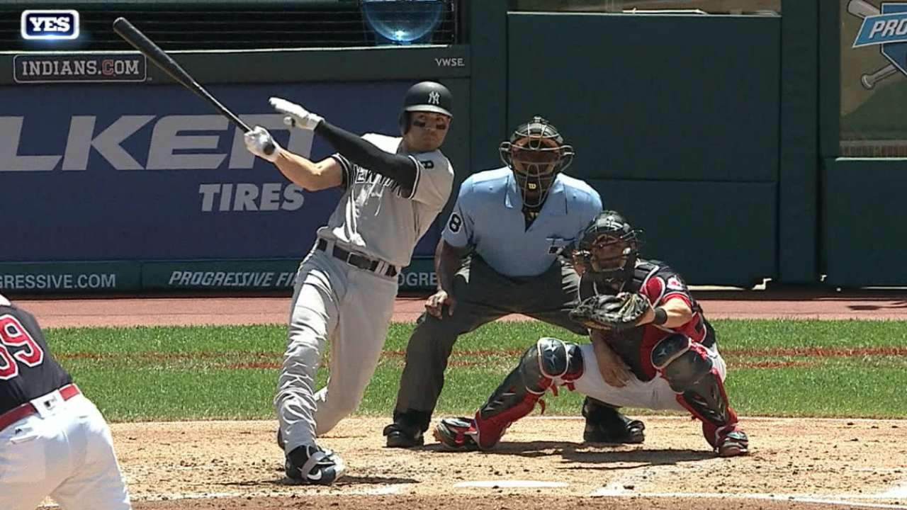 Yanks ride offensive bursts, hang on vs. Tribe