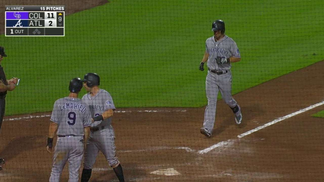 CarGo collects 3 hits, Raburn slams in win over Braves